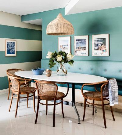Beach Style Dining Room by Brett Mickan Interior Design