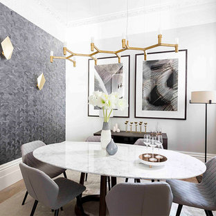 Photo of a contemporary dining room in London with grey walls, light hardwood flooring and no fireplace.