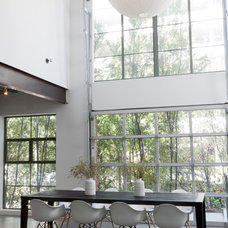 Industrial Dining Room by DISC Interiors