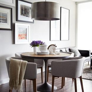 Inspiration pour une salle à manger ouverte sur le salon traditionnelle de taille moyenne avec un mur gris, un sol en bois foncé et aucune cheminée.