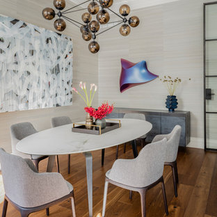 Inspiration for a mid-sized contemporary medium tone wood floor and brown floor enclosed dining room remodel in Boston with gray walls