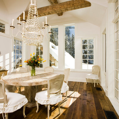 Inspiration for a mid-sized rustic dark wood floor and brown floor great room remodel in Denver with white walls and no fireplace