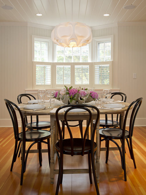 Example Of A Mid Sized Mountain Style Medium Tone Wood Floor Dining Room  Design In