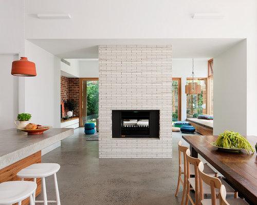 salle manger avec un manteau de chemin e en carrelage et un sol en b ton photos et id es. Black Bedroom Furniture Sets. Home Design Ideas