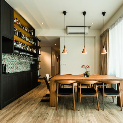 Inspiration for a transitional light wood floor and beige floor enclosed dining room remodel in Singapore with beige walls