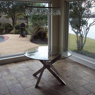 Dining room - contemporary ceramic tile dining room idea in Houston