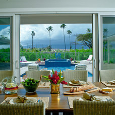 Tropical Dining Room by Heffel Balagno Design Consultants