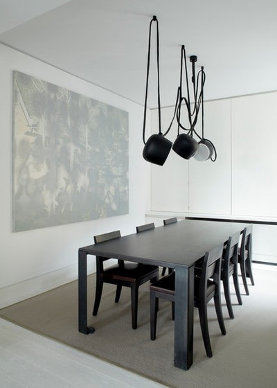Modern Dining Room by TLA Studio