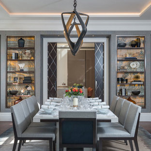 Photo of a medium sized traditional enclosed dining room in London with grey walls, dark hardwood flooring and brown floors.