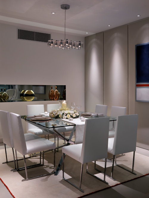 Example of a trendy dining room design in London. Glass Dining Table   Houzz