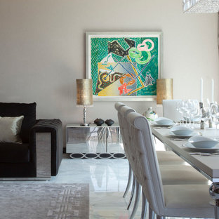 Inspiration for a contemporary marble floor dining room remodel in London