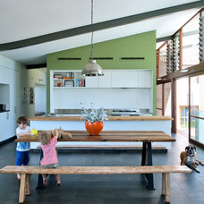 Midcentury Dining Room by Klopper and Davis Architects