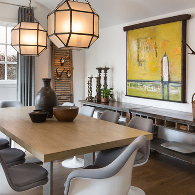 Large transitional medium tone wood floor and brown floor enclosed dining room photo in Orange County with white walls and no fireplace