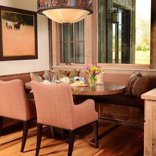 Mid-sized mountain style dark wood floor kitchen/dining room combo photo in Other with white walls and no fireplace