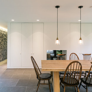 Design ideas for a medium sized contemporary dining room in Kent with grey floors.