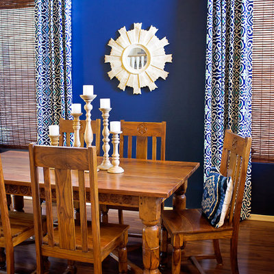 Inspiration for a mediterranean dining room remodel in Phoenix with blue walls