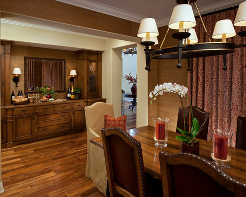 Traditional Dining Room Idea In Orange County With Brown Walls And Dark Wood Floors