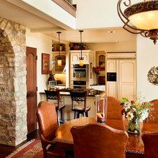 Mediterranean Dining Room by Morey Remodeling Group