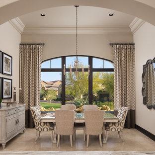 Immagine di un'ampia sala da pranzo mediterranea chiusa con pareti beige, pavimento in marmo, camino classico, cornice del camino in pietra e pavimento beige