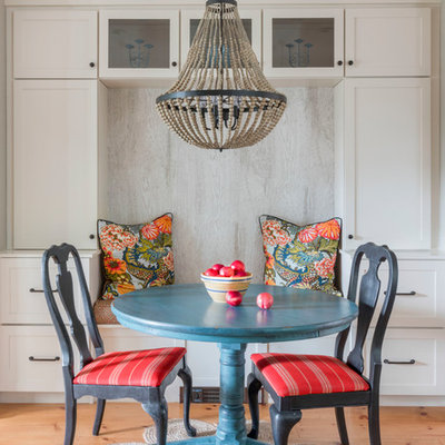 Example of a small beach style light wood floor and beige floor dining room design in Boston