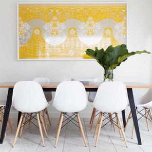 Foto di una piccola sala da pranzo aperta verso la cucina design con pareti bianche e pavimento in gres porcellanato