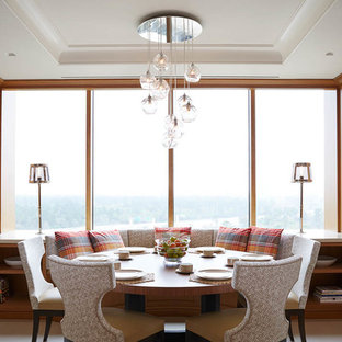 Example of a transitional dining room design in Houston