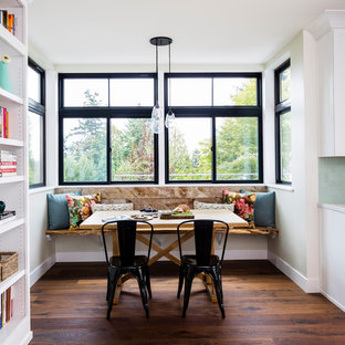 Example of a small cottage dark wood floor and brown floor kitchen/dining room combo design in Seattle with beige walls and no fireplace
