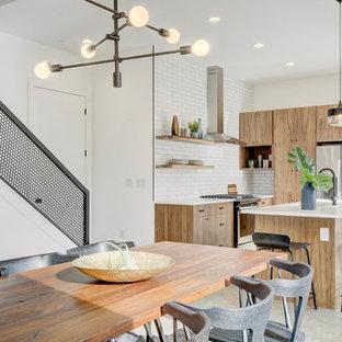 Esempio di una sala da pranzo aperta verso la cucina industriale con pareti bianche, pavimento in cemento e pavimento grigio