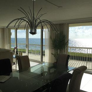 Example of a trendy dining room design in Miami