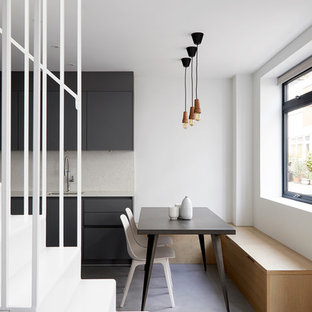 Inspiration for a small contemporary kitchen/dining room in London with grey floors, white walls, concrete flooring and no fireplace.