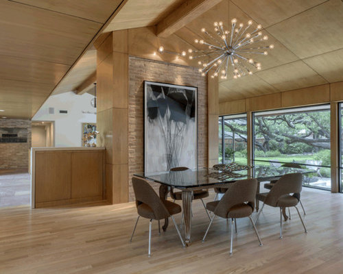 Inspiration for a mid sized midcentury modern light wood floor and beige floor dining room