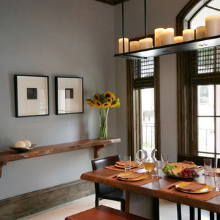 Example of a trendy beige floor dining room design in Miami with gray walls
