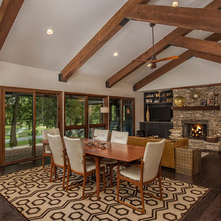 Inspiration for a rustic dark wood floor great room remodel in Other with white walls