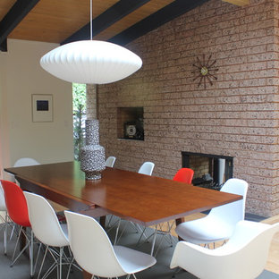 Inspiration for a modern dining room remodel in San Francisco with a two-sided fireplace