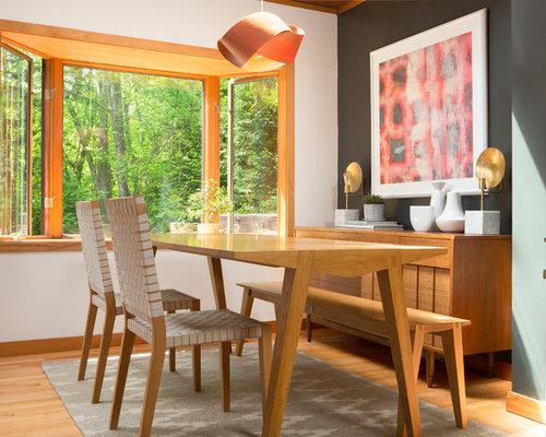 1950s medium tone wood floor dining room idea in seattle with black walls - Mid Century Modern Dining Room Ideas