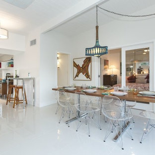 Kitchen/dining room combo - contemporary linoleum floor kitchen/dining room combo idea in Los Angeles with white walls