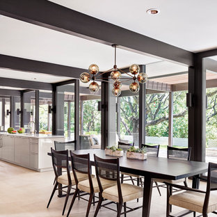 Kitchen/dining room combo - large contemporary limestone floor and beige floor kitchen/dining room combo idea in Austin with no fireplace and white walls