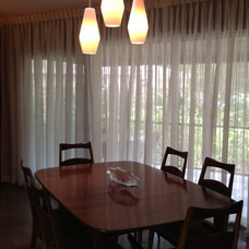 Midcentury Dining Room by ionDesign,LLC