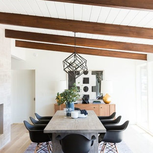 Example of a 1950s light wood floor and beige floor dining room design in Salt Lake City with white walls