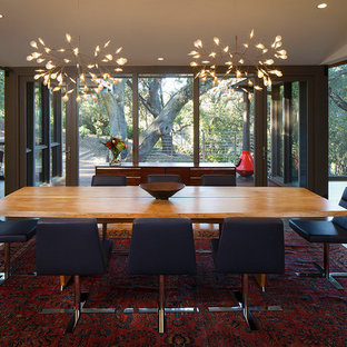 Inspiration for a mid-sized mid-century modern dark wood floor enclosed dining room remodel in San Francisco with white walls