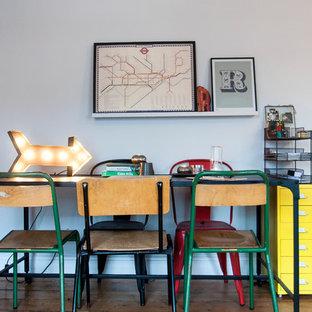 Dining room - midcentury modern dark wood floor dining room idea in London with white walls