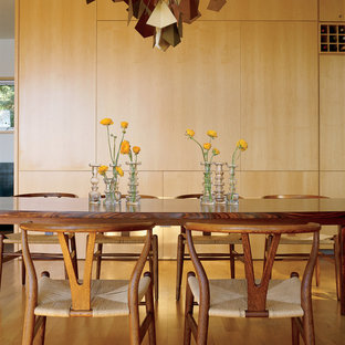 This is an example of a midcentury dining room in New York with medium hardwood floors.