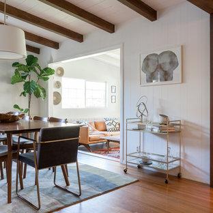 Great room - large midcentury modern medium tone wood floor and brown floor great room idea in Los Angeles with white walls