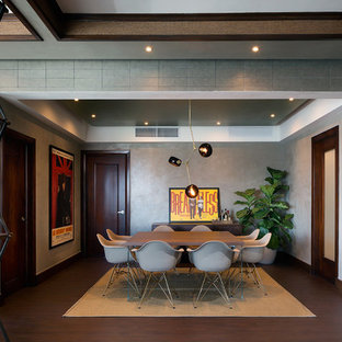 Example of a mid-sized 1950s laminate floor and brown floor dining room design in Other with gray walls