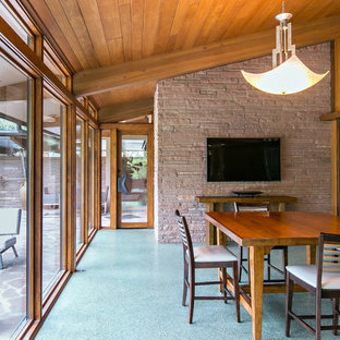 Enclosed dining room - 1950s blue floor enclosed dining room idea in New Orleans
