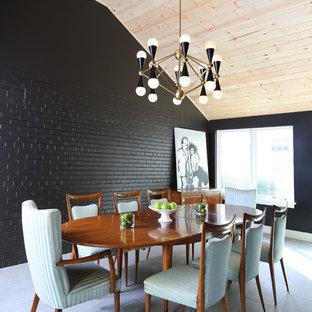 Foto di una sala da pranzo moderna di medie dimensioni con pareti nere, pavimento in gres porcellanato e nessun camino