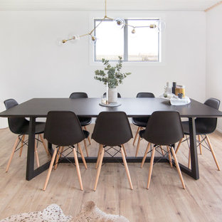 Example of a mid-sized danish laminate floor and beige floor kitchen/dining room combo design in Auckland with white walls and no fireplace