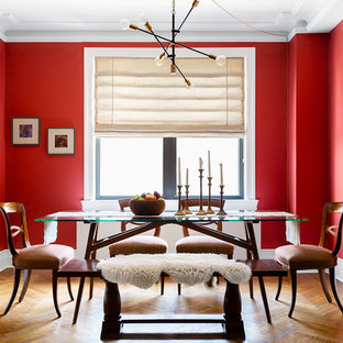 Dining room - large 1960s medium tone wood floor and brown floor dining room idea in New York with red walls