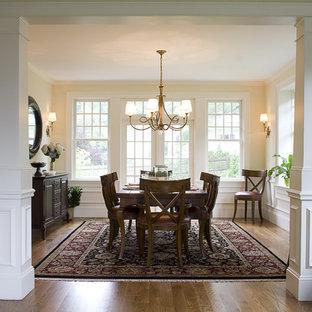 Dining room - traditional medium tone wood floor dining room idea in Boston with beige walls