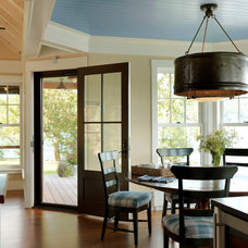 Beach Style Dining Room by Cushman Design Group